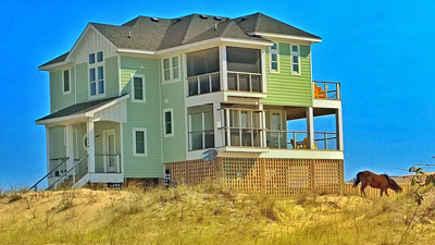 Best 4x4 House Builder Carova Beach Swan Beach Carolla Outer Banks Tab Winborne MLS Lots & Homes Spec Houses construction Insured Certified Licensed contractor Custom Luxury Costal Homes Phone 757.237.2802  On the beach wild horses